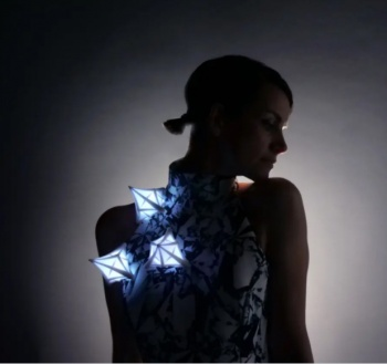 Meteor Dress creation is an illuminating star gazing dress with 3D printed parts