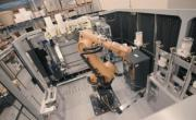 An industrial robotic arm can swap out used pellet containers or tool heads in Stratasys' Infinite Build Demonstrator. (Image co